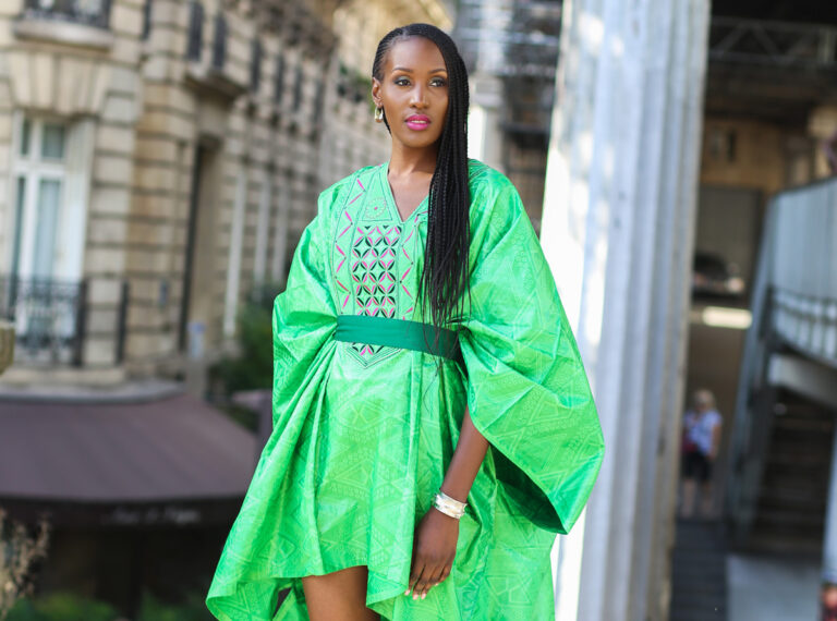 Nil from Women of the African Diaspora photo book wearing DBN Bazin and Fulaba Fulani jewelry